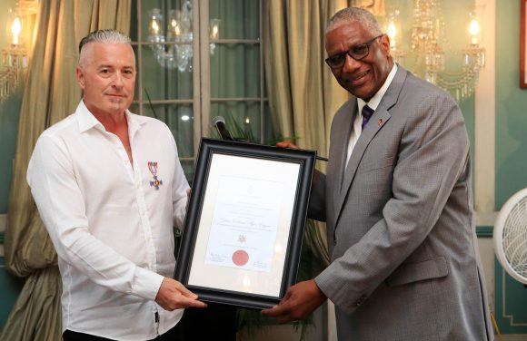 Calvin Ayre receives Antigua's Faithful & Meritorious Service Cross Award