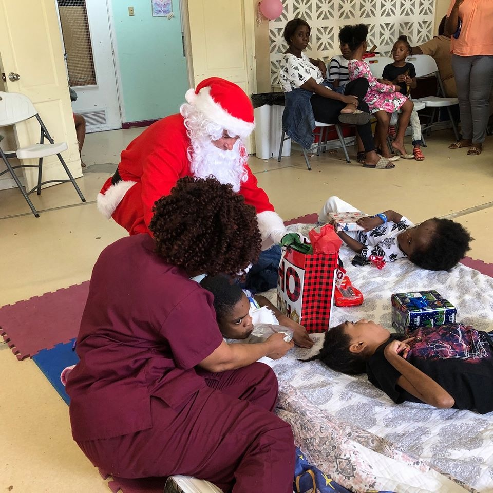 SANTA BRINGING HOLIDAY MAGIC TO DISADVANTAGED KIDS
