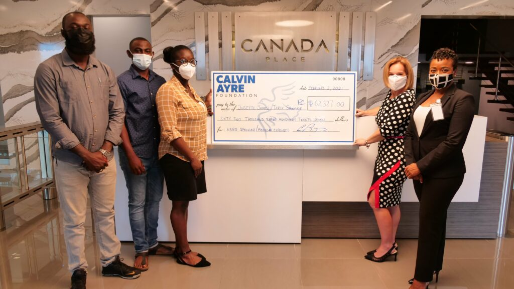CAF Executive Director & Media Relations Specialist hand over check to Kairo's family
